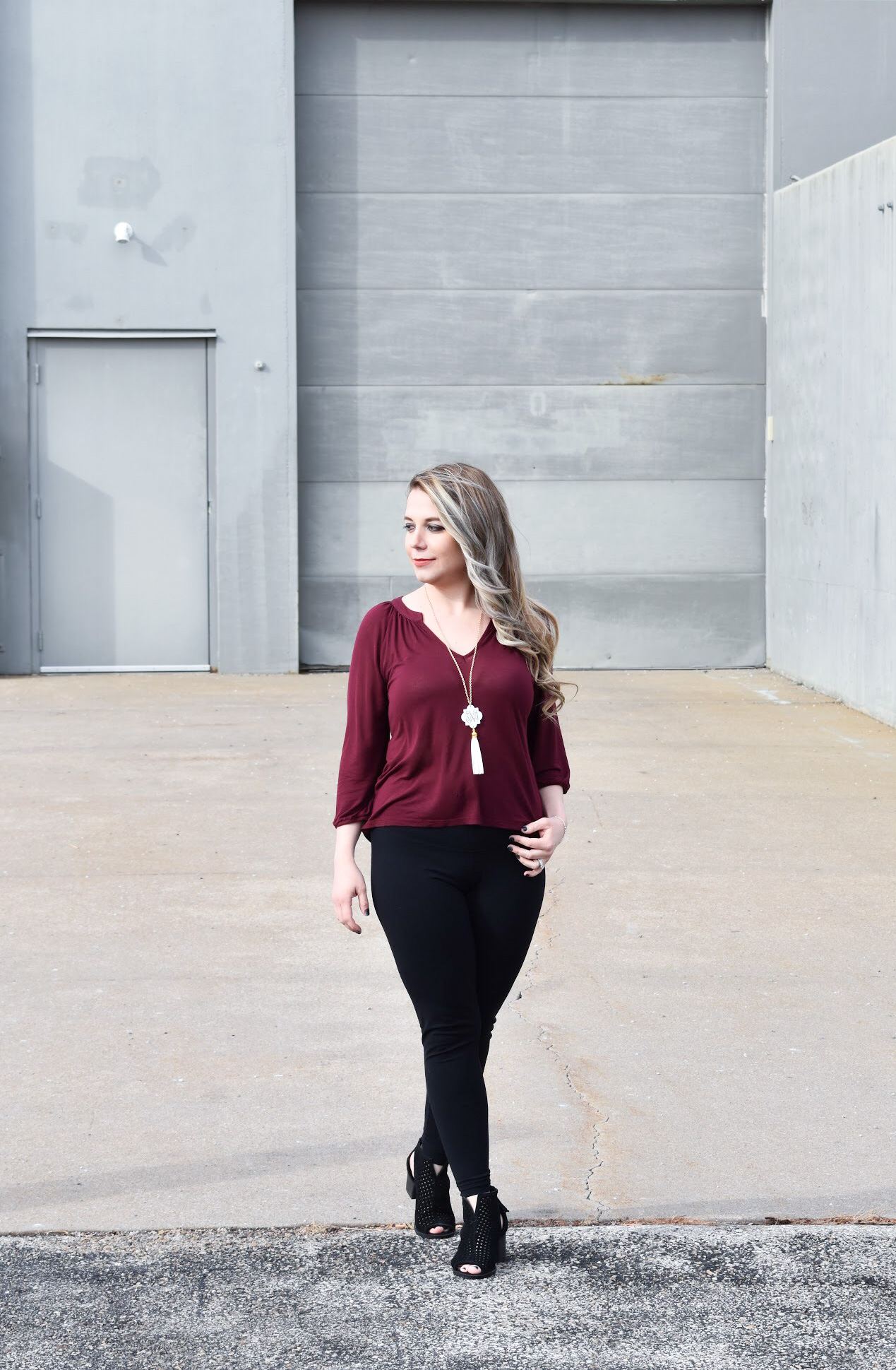 Dress Up Leggings with Ankle Boots. One of my favorite outfit ideas for leggings is to dress the leggings up with some stylish ankle boots! Take leggings from day to night with this easy styling trick! Here, I styled black leggings with black ankle boots for a sleek monochromatic look.