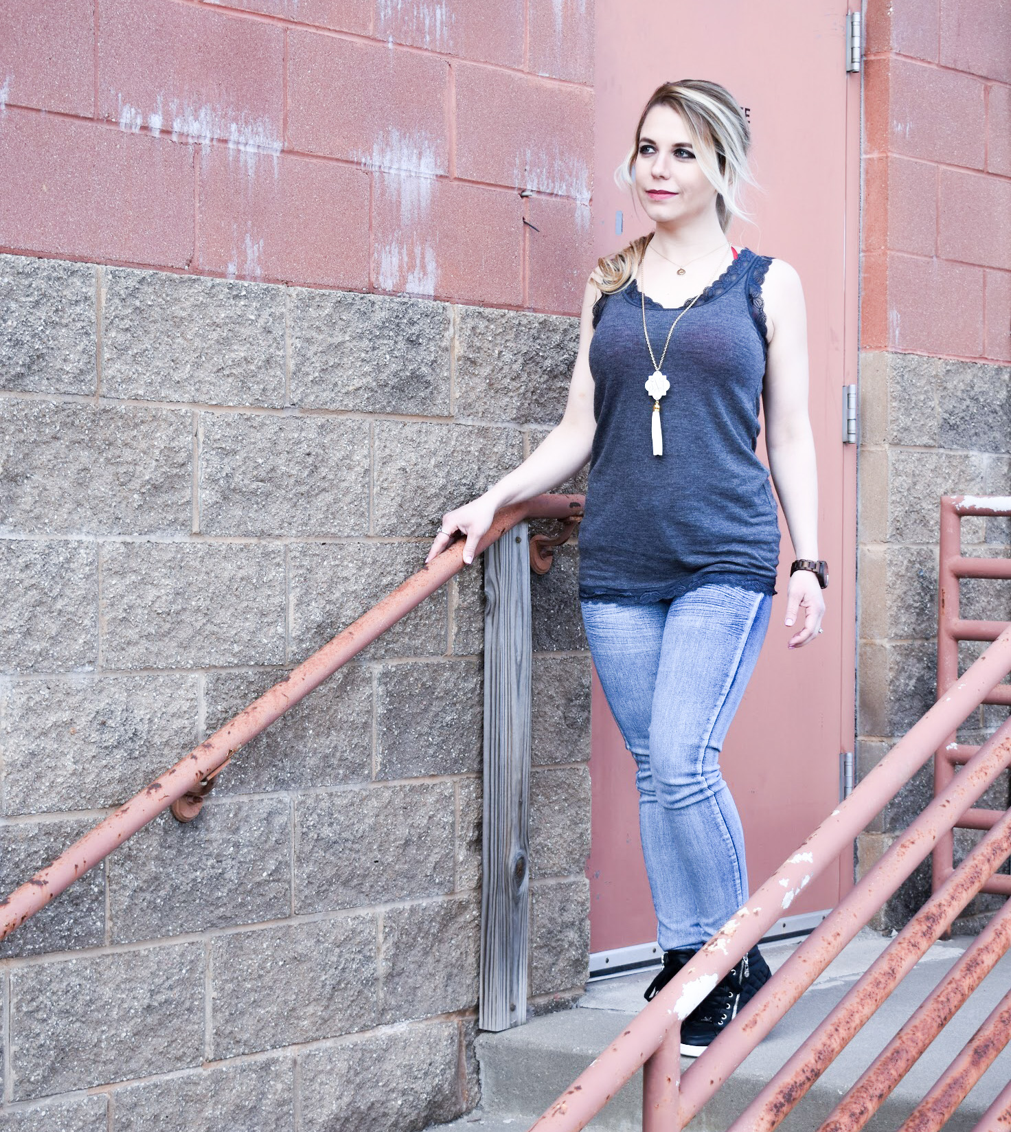 What to Wear Under a Lace Back Top: Lace back tops, open back tops, and sheer blouses present unique wardrobe challenges. Here's how fashion blogger COVET by tricia styled a lace back tank top with skinny jeans and wedge sneakers for a fun warm weather look! Sometimes, the best way to work the lace back is to simply embrace the exposed bra look with a fun bra or bralette!