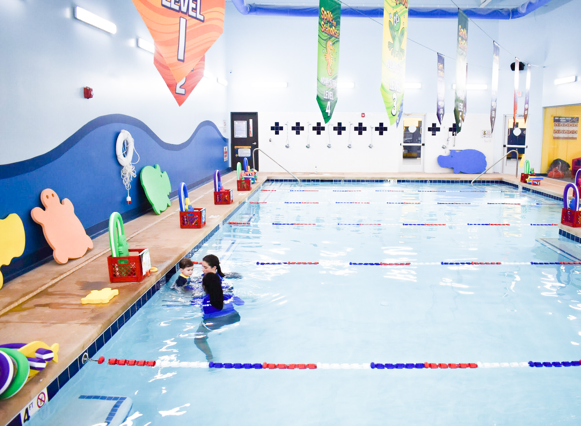 What to Expect at Baby Swim Lessons: Prepare yourself and your child for their first swim lesson with these tips! My infant and preschooler take lessons at Aqua-Tots Swim School in Olathe, KS. Here's what I learned from the pros about baby swim lessons and getting kids acclimated to the water!