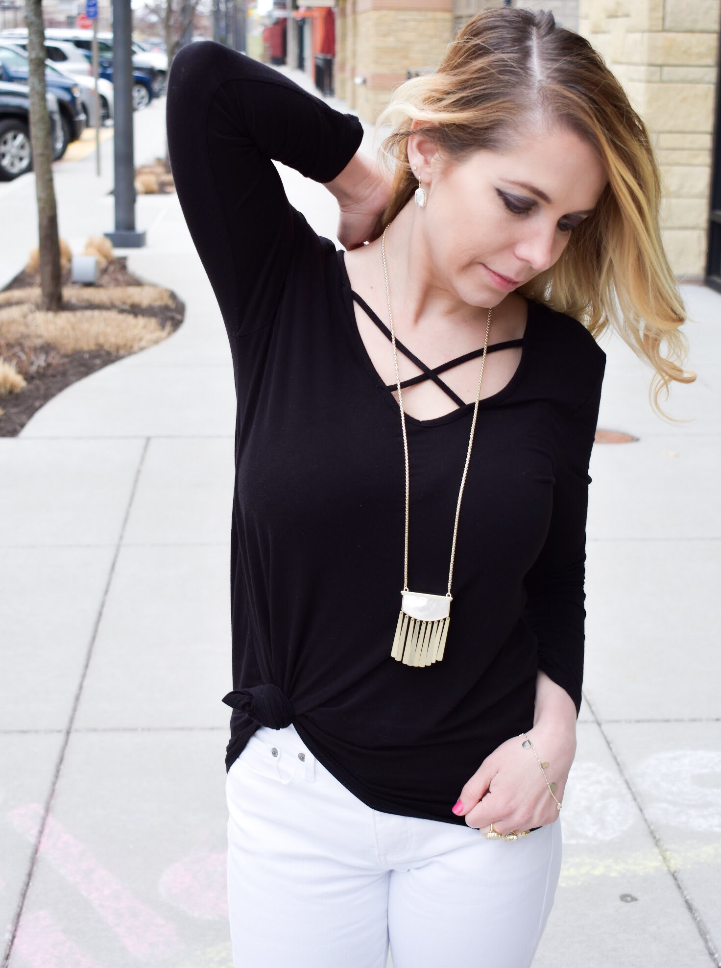 Monochrome Kendra Scott Jewelry Look: Kansas City fashion blogger COVET by tricia showcases a black and white spring transitional spring style featuring Kendra Scott jewelry. Here's how to style a knotted blouse with white pants, peep-toe heels, and gorgeous jewelry from Kendra Scott. The jewelry used in this post is available from Threshing Bee in Overland Park, KS.
