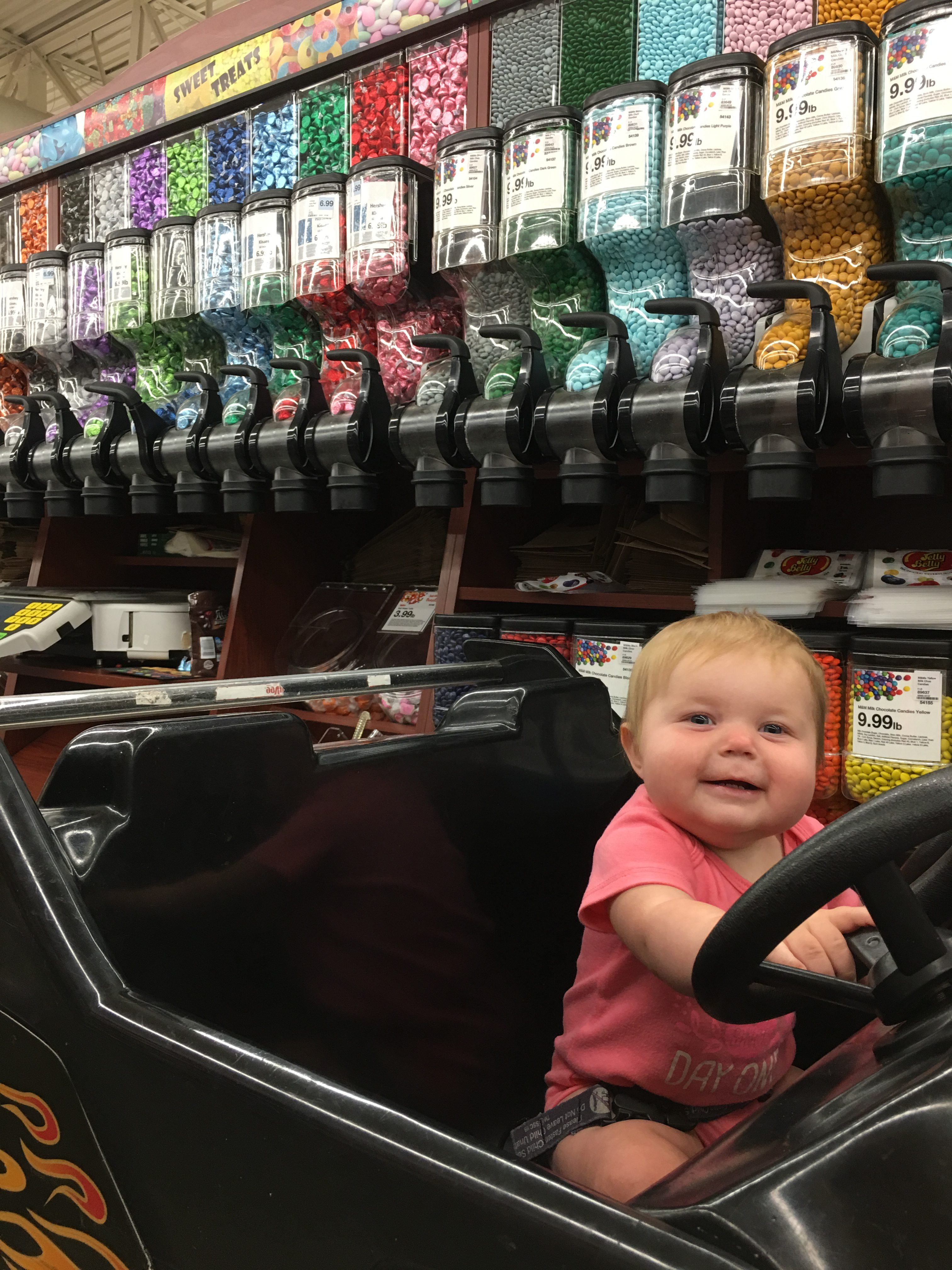 Baby in Car Cart Buying Candy e1529355018970