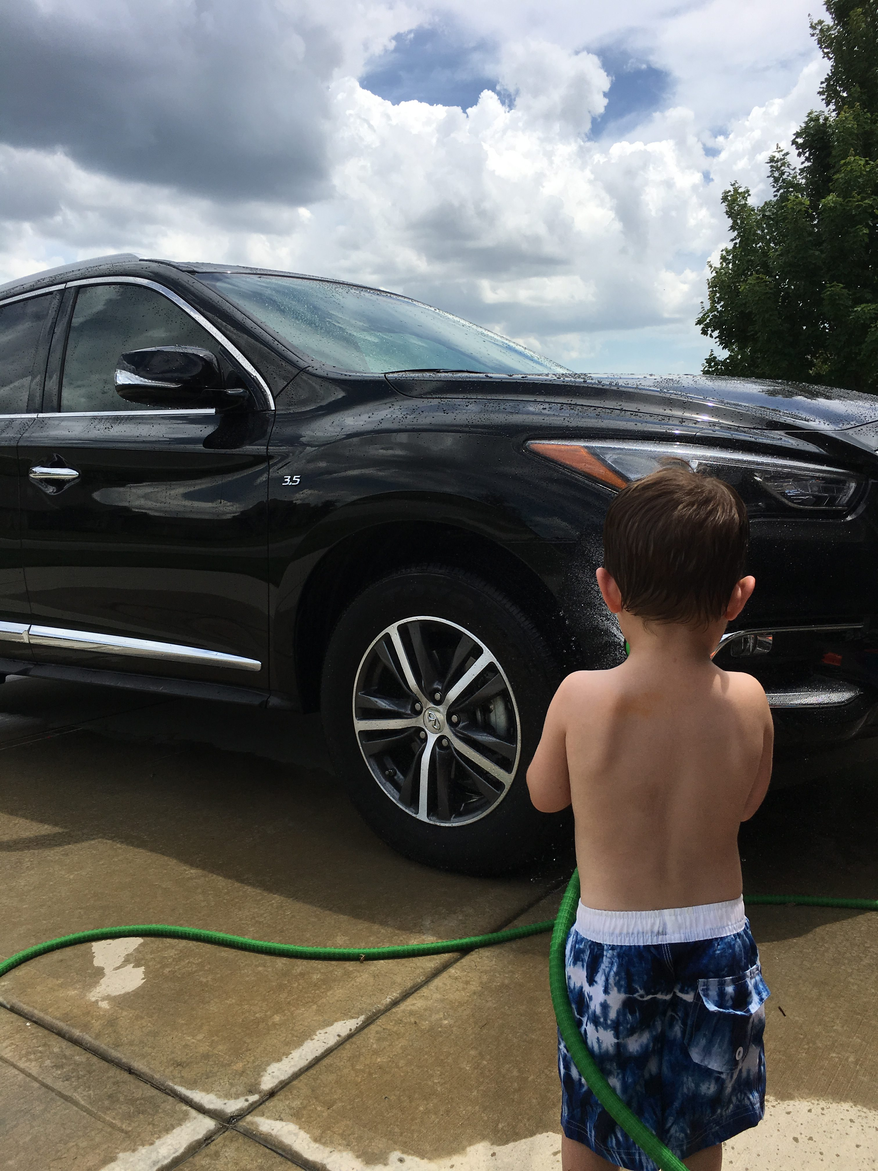 Toddler Boy Washing Infiniti QX60 e1529354942879