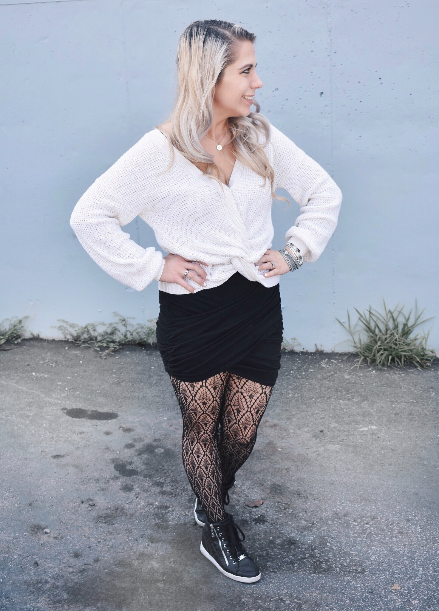 Fishnet Tights Outfit Ideas - Fall Street Style 2018 - Fashion blogger fishnet tights outfit showing how to use fishnet tights to transition your wardrobe to fall. Fishnet tights and mini skirt outfit helps you with how to wear a mini skirt in fall. Plus, this twist-front sweater is the cutest you'll ever see! Check out this Street Style Fall 2018 inspiration! #LikeTKit #Fishnets #FishnetTights #FallFashion #WomensFashion