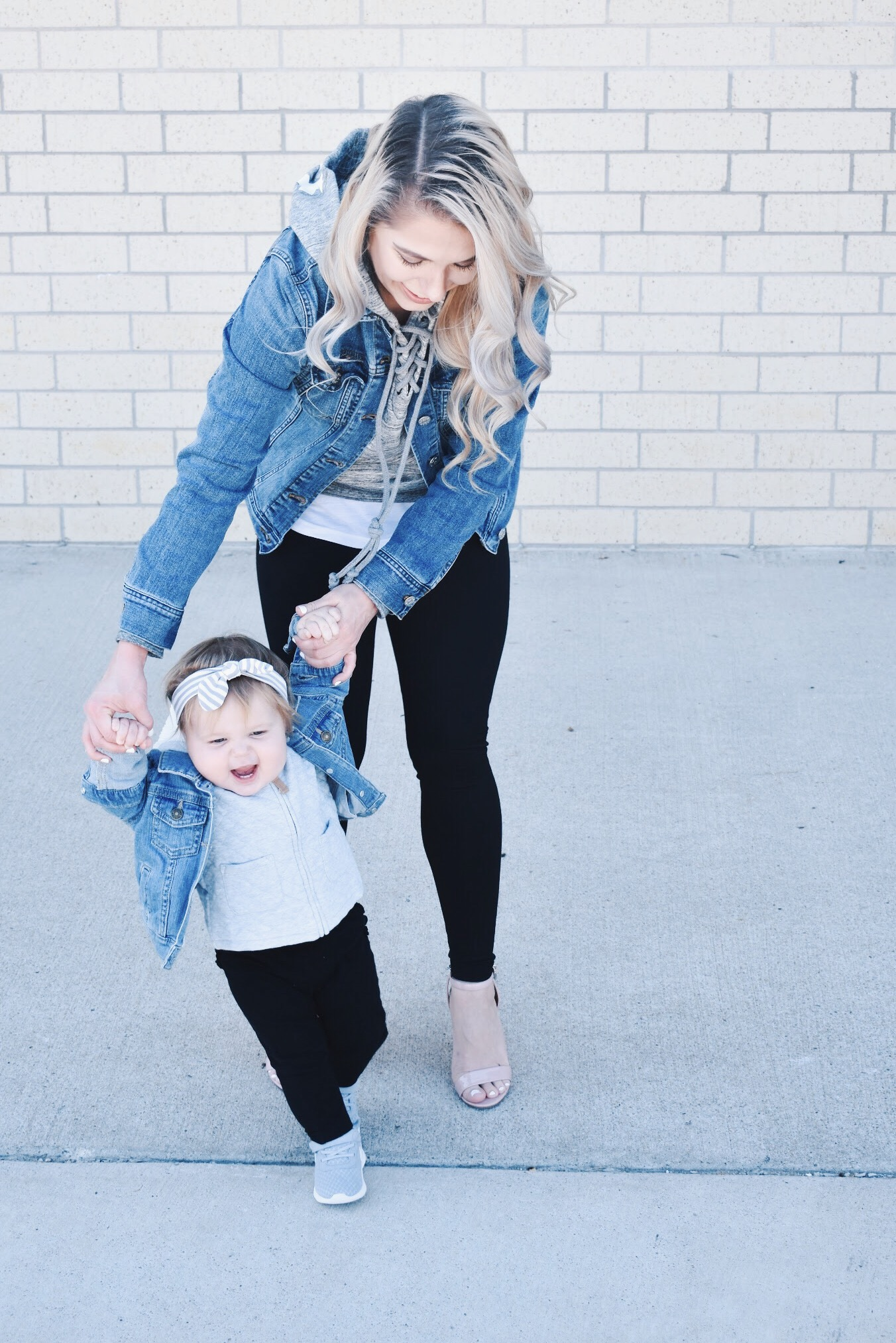 Mommy and Me Matching Outfits - Mom and Baby Girl Matching Outfits - Here's some of the best Mommy and Me Outfit Ideas on the Internet! This casual Mommy and Me style jean jacket over hoodie look can work for a baby girl or baby boy and is easy to pull together with items you both probably already have in your closets. Jean jacket outfit ideas, Hoodie outfit ideas, Casual Fall Style, Casual Fall Outfit. #LikeTKit #Fashion #MommyandMe #Twinning