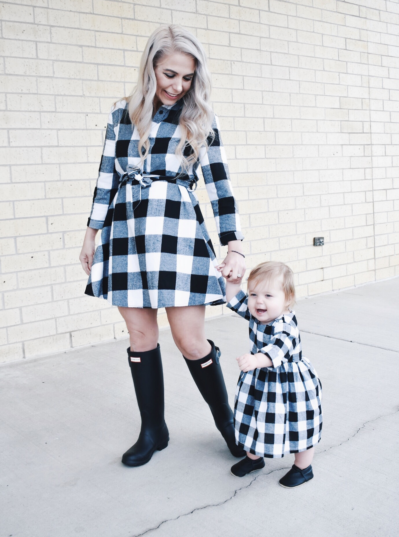 Mommy and Me Dresses - Fall Matching Clothes for Mommy and Daughter. These Mommy and Me plaid dresses are perfect for twinning with your mini me. Best of all, they're super affordable -- you can get both dresses for around $30 total! Perfect Mommy and Me outfit inspo from fashion blogger Tricia Nibarger of COVET by tricia, showcasing plaid dresses for Mom and Daughter. #MommyandMe #GirlMom #LikeTKit