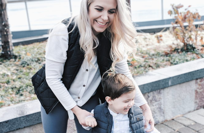 Mommy and Me Outfits - Winter Style: Fashion blogger Tricia Nibarger of COVET by tricia showcases twinning looks for the winter! Find the cutest mommy and me fashion for boy moms or girl moms with these matching puffer vests, henleys, and Hunter boots. Casual winter style for moms. #MommyandMe #MomLife #Twinning