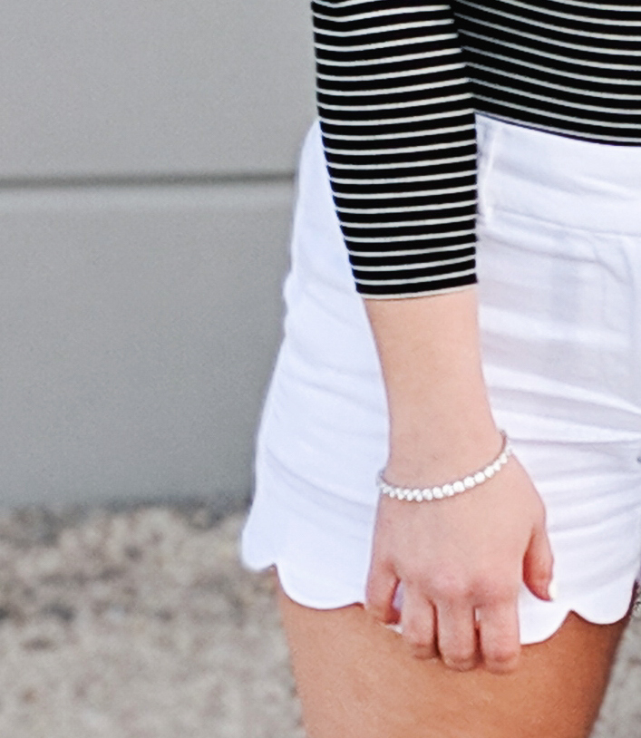 #sponsored This gorgeous tennis bracelet is the perfect finishing touch to this black and white spring outfit! The tennis bracelet is from @Kohls fine jewelry collection and matches everything! I love the sparkle it adds to this black bodysuit and white scalloped shorts outfit for spring fashion 2019. #KohlsJewelry #KohlsFinds #WomensFashion #SpringStyle