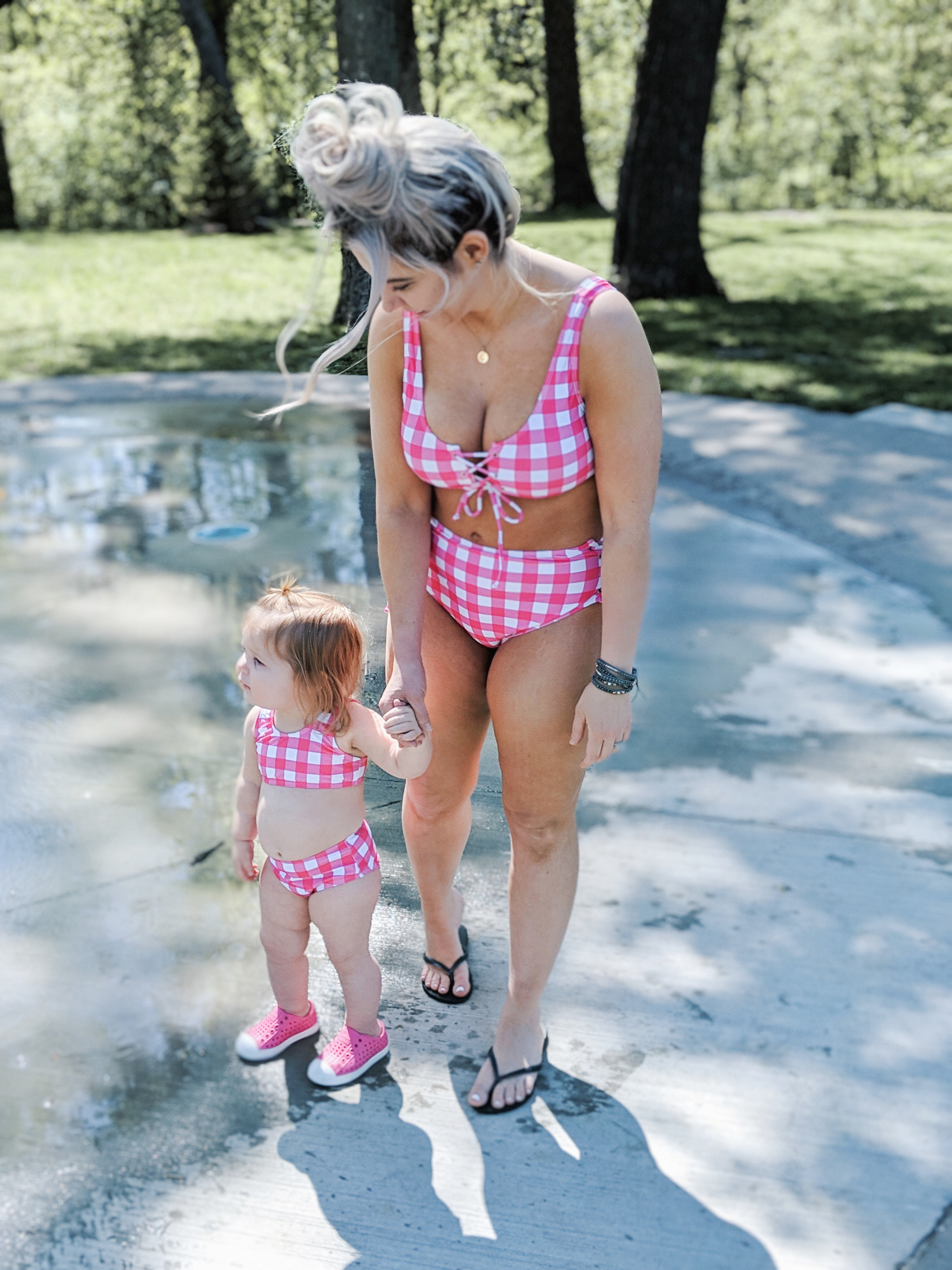 Mommy and Me Swimsuits Baby Girl: The cutest mommy and me swimsuits for baby girls! Featuring mommy and me one piece swimsuits and mommy and me bikini swimsuits so you'll find the best mommy and me swimwear for you and your mini me! Fashion blogger Tricia Nibarger of COVET by tricia showcases mommy and me swimsuits with her daughter. #mommyandme #girlmom #swimsuits