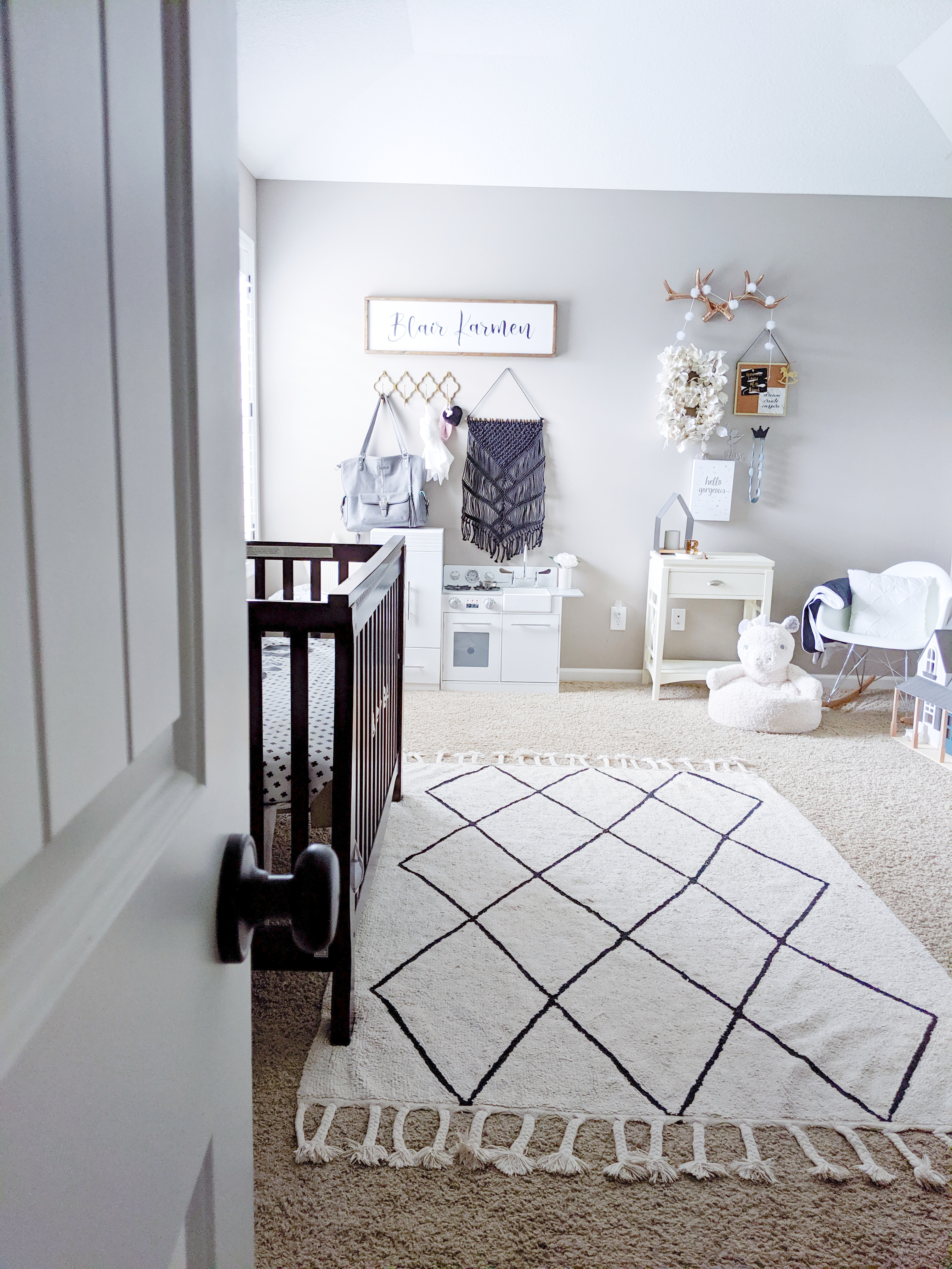 This is the cutest baby girl nursery! Exactly how I want my baby girl nursery to look. I love that it's a baby girl nursery not pink! Baby girl nursery monochrome, grey and white nursery, baby girl nursery ideas not pink. #babygirlnursery #nurserydecor #girlnursery