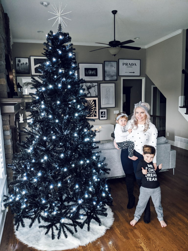 Family by Black Christmas Tree • COVET by tricia