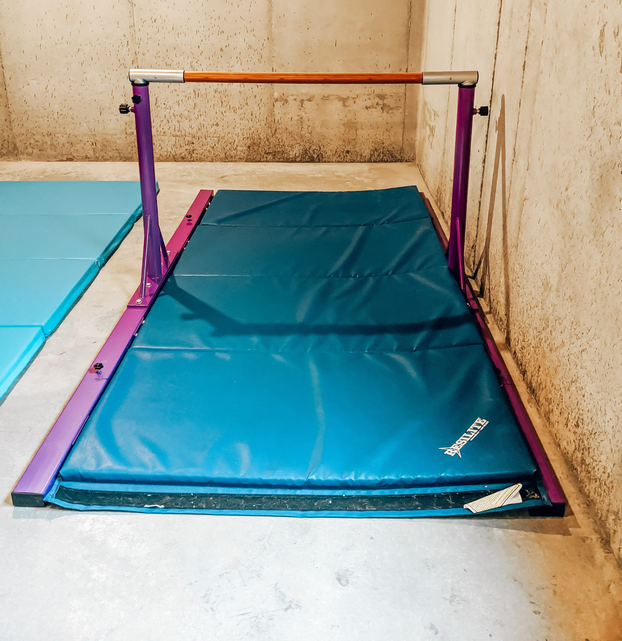 Best Gymnastics Equipment for Home - Home Gymnastics Setup - Home Gymnastics Equipment: Kansas City blogger Tricia Nibarger shows the best gymnastics equipment for home with her family's home gymnastics setup! #gymnastics #littlegymnast #gymnast