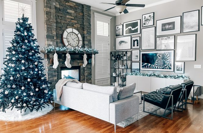 Modern Living Room Christmas Decor - Blogger Tricia Nibarger shares living room Christmas decor in her modern home, featuring a black Christmas tree and a monochrome Christmas theme! #modern #christmasdecor #blackchristmastree